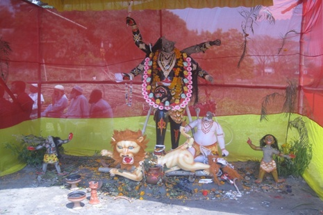 <p>A vandalized statue of the Hindu goddess Kali on display inside a canopy in Bonogram village in northwestern Bangladesh.</p>
