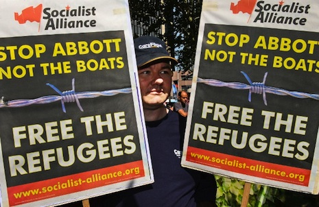 <p>Protesters carry placards at a 'Welcome Refugees' rally in Sydney last year (AFP/William West)</p>