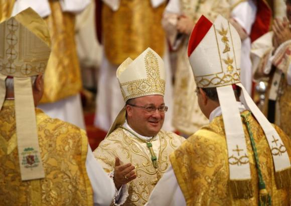 <p>Auxilliary Bishop of Malta Monsignor Charles Scicluna at his ordination ceremony in Rome in 2012 (Reuters/Darrin Zammit Lupi)</p>