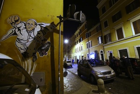 <p>Graffiti image of Pope Francis as Superman on a wall in the Borgo Pio district of Rome near St Peter's Square (Gregorio Borgia/AP)</p>