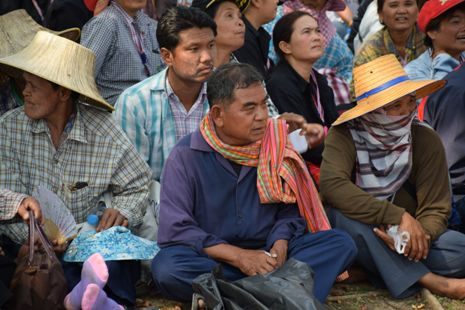<p>Farmers occupy the grounds of the Ministry of Commerce in Bangkok during a protest over missing government payments from the previous rice harvest. (Photo by Stephen Steele)</p>