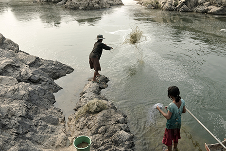 <p>People fish in the Mekong River below Khone Falls close to the Laos-Cambodian border (photo&nbsp;&copy; Fletcher &amp; Baylis / WWF-Greater Mekong)</p>