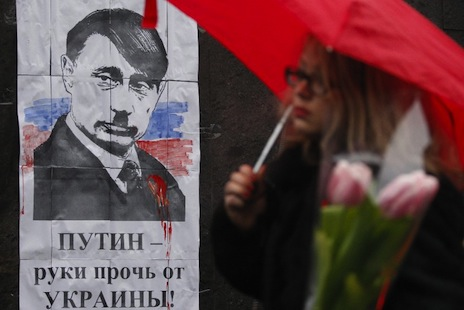 <p>A poster depicting Russian leader Putin as Hitler, with the slogan 'Hands Off Ukraine' (picture: AFP Photo/Yury Kirnichny)</p>