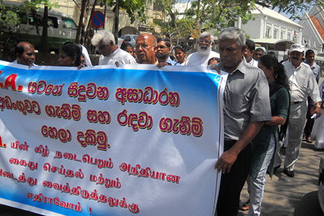 <p>Rights activists march&nbsp;to the Ministry of Justice in Colombo yesterday to hand over a petition calling for repeal of the Prevention of Terrorism Act.</p>