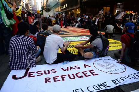 <p>Australians protest against the asylum seeker policy in Sydney in August 2013 (AFP photo/Saeed Khan)</p>