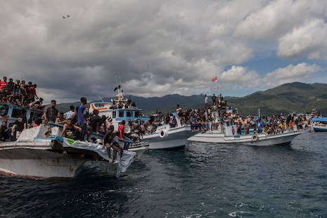 <p>Boats overloaded with Christian pilgrims participate in a sea procession before the disaster on Good Friday (picture: AFP Photo)</p>