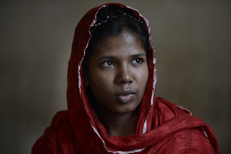 <p><span class=&quot;Apple-style-span&quot;>Bangladeshi garment worker Reshma Akter, who was rescued from the rubble of Rana Plaza 17 days after it collapsed, sits at her sister's house in Saver on the outskirts of Dhaka. (Picture:&nbsp;<span class=&quot;Apple-style-span&quot;>AFP Photo/Munir uz ZAMAN)</span></span></p>
