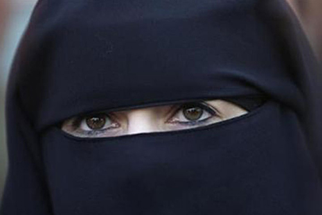<p>A young women wearing a black burqa which has a separate piece of cloth to cover the head and face in order not to impede the vision of the person wearing it. (Picture: Dawn.com)</p>