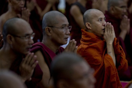 <p>Ashin Wirathu (far right), leader of a Buddhist nationalist movement in Myanmar (picture: Religion News Service)</p>
