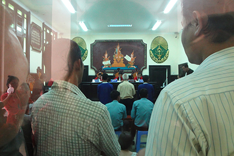 <p>Journalists watch a March 2013 Appeal Court trial of broadcaster Mam Sonando, who was arrested on charges widely believed to be politically motivated. (photo by Abby Seiff)&nbsp;</p>