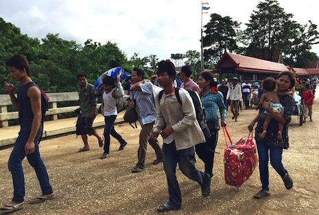 Cambodian exodus from Thailand becomes a stampede