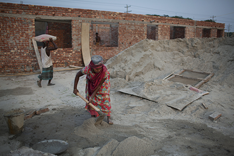 <p>A laborer mixes cement on a plot of land where a tannery is being built at the Savar industrial estate (photo by Will Baxter)</p>