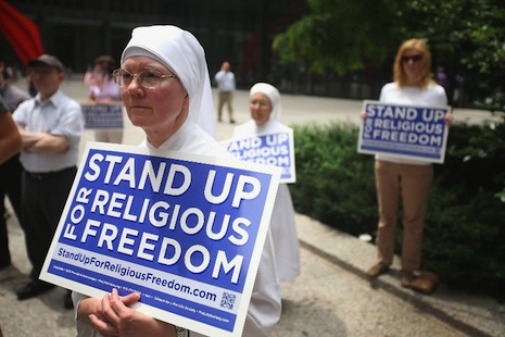 <p>A nun awaits the Supreme Court decision on June 30. Picture: AFP Photo/Getty Images/Scott Olson</p>