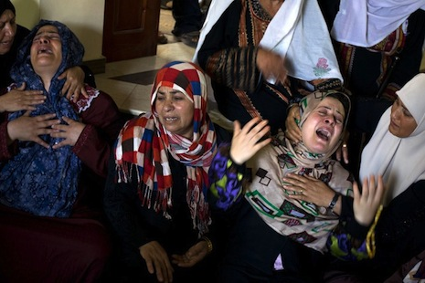 <p>Palestinian women grieve over family deaths after an Israeli air strike hit their Gaza Strip home. Picture: AFP Photo/Mohammed Abed</p>