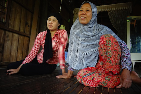 <p>Ly Mai (right) and her daughter, Lo Mat Husna, at their home in Svay Khleang village</p>