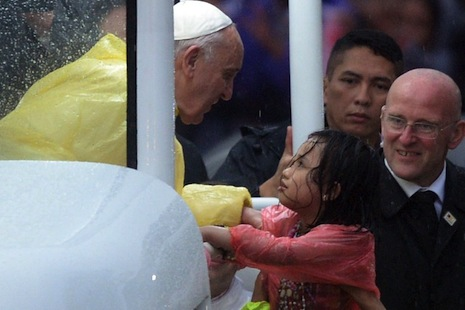 Pope attracts world-record crowd in rain-soaked Philippines