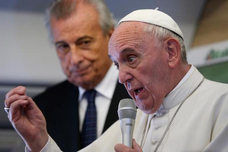 Meeting media, pope defends his teaching on social issues
