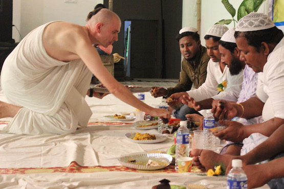 ISKCON devotee serves food at Muslim iftar
