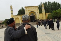 What does China's white paper offer Xinjiang's Muslims?