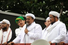 Indonesian police charge hard-line cleric