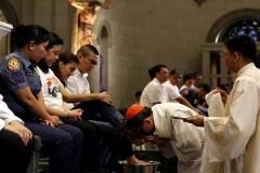 Cardinal Tagle kisses feet of former drug addicts