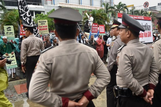 Widodo issues decree allowing the banning of radical groups