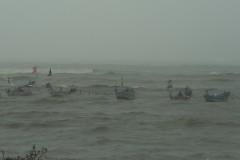 Black flags, burning incense mark sea tragedy