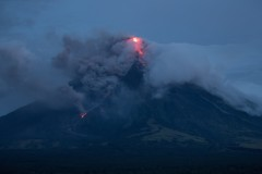 Imminent eruption of Philippine volcano attracts tourists