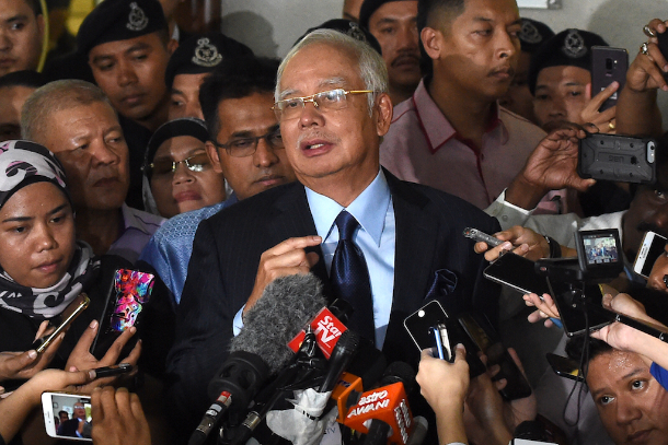 Malaysian ex-PM hit with 25 charges over 1MDB scandal