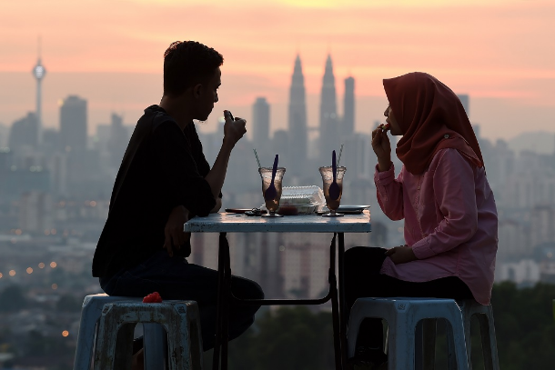 Malaysia to rein in policing of morals