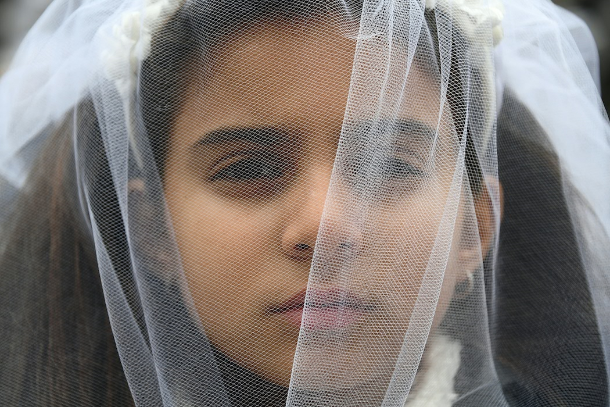 Indonesian religious court rebuked over child marriages