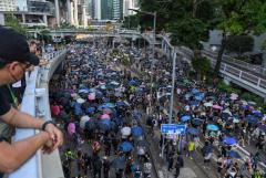 Hong Kong Catholics pray as thousands defy police