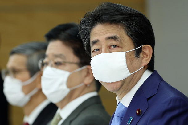 Japan extends emergency as health system strains