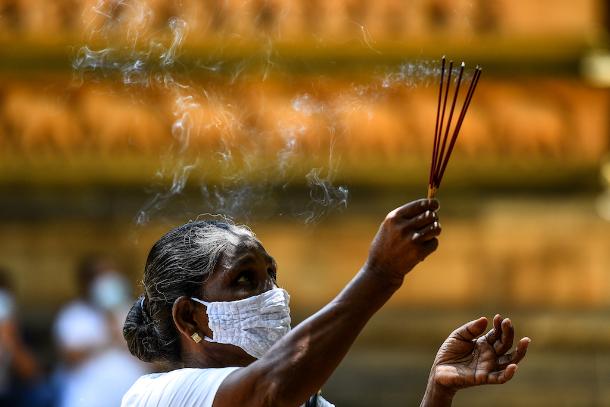 Despite curfew, Sri Lankan Buddhists celebrate Poson Poya