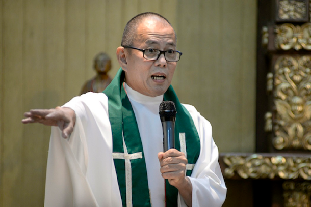 Priest critic of Duterte accuses police of spying on him