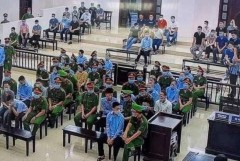 Call to suspend murder trial of Vietnam farmers