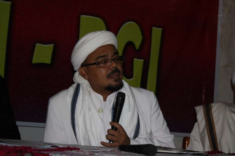 Indonesian police slap Covid-19 charge on fugitive cleric