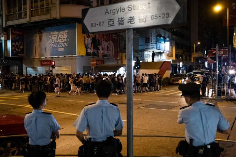 Hong Kong police arrest top writer from shuttered Apple Daily
