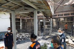 Indonesia charges three prison officers over deadly fire